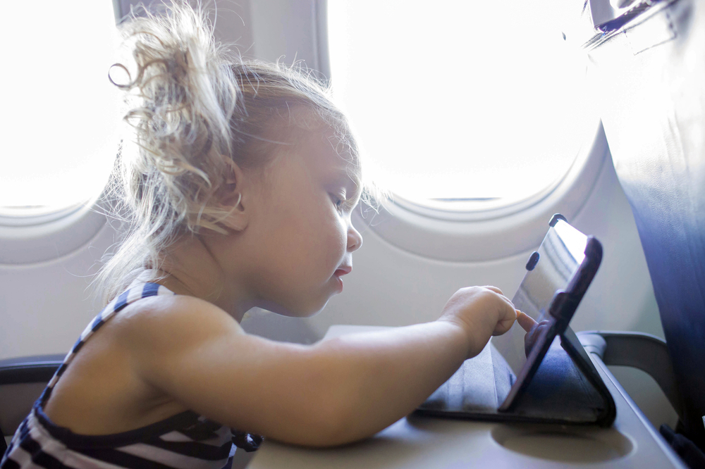 how to travel with young kids on an airplane.