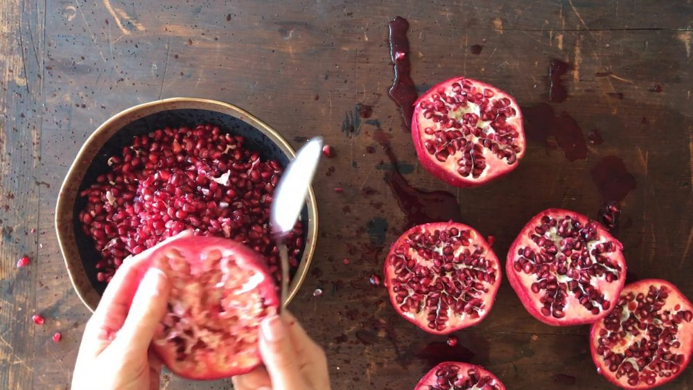 how to deseed a pomegranate in minutes. Ever buy a case of pomegranates? Here's how to easily deseed them!