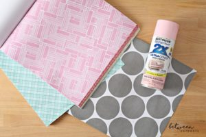 The Trick: Using Paper You can use all these tricks with simply one value pack of scrapbook paper, available in different colors and styles at craft stores such as A.C. Moore or Michaels. There's usually some styles available in the clearance section, though they might not match the look you're after. Don't forget your 40% off coupon! You can also go with more specialty papers and cardstocks, but make sure to grab those when they're on sale.