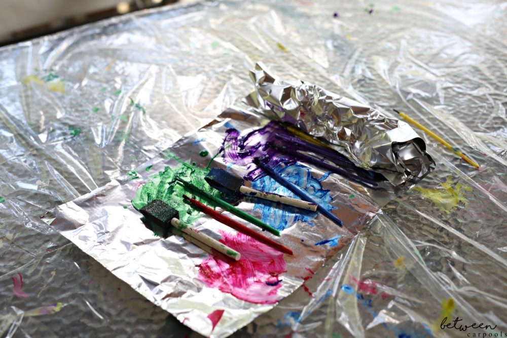 paint on silver foil; dirty paintbrushes