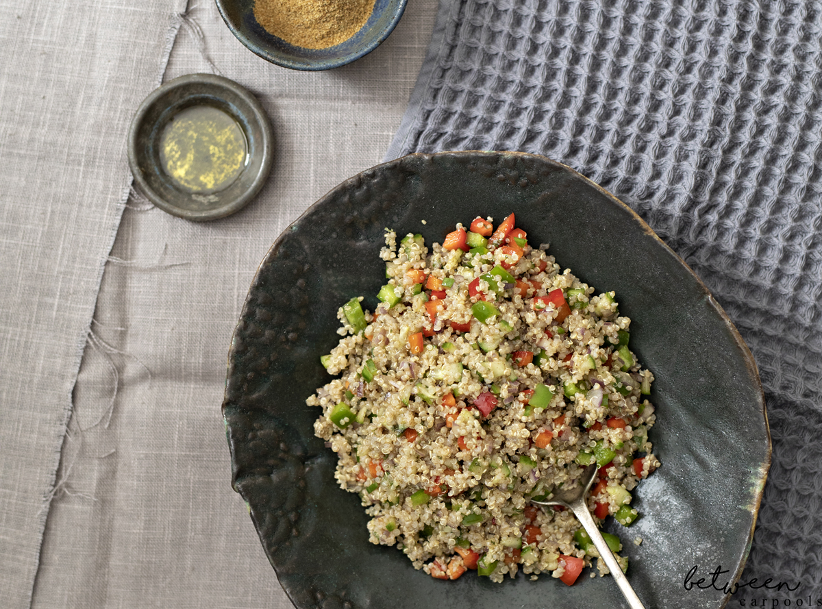 This is Our New Favorite Fresh and Amazing Quinoa Salad. Cook your quinoa, chop those fresh crunchy veggies nice and finely, and you're all set with this great salad.