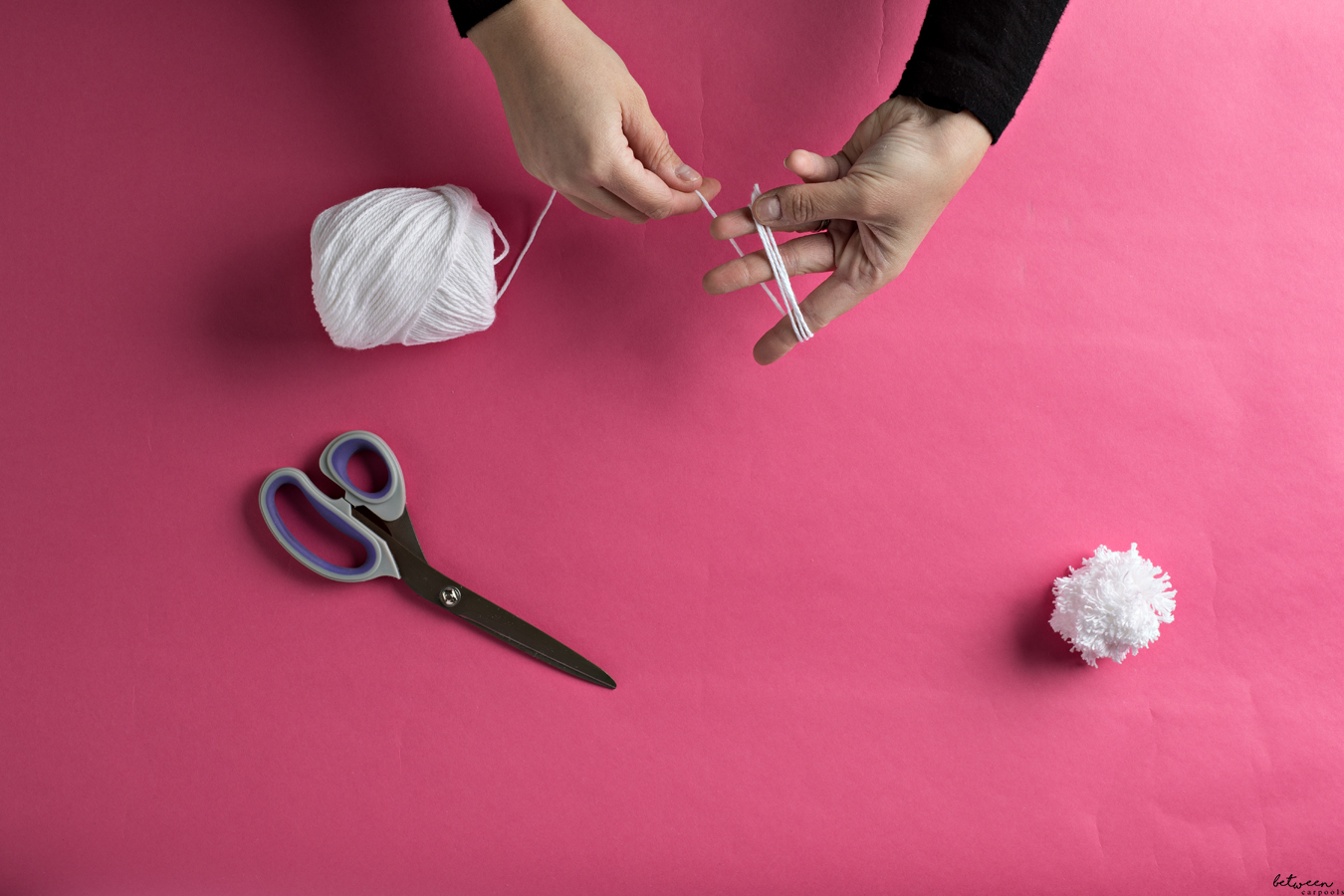 How to Make Your Own Pom Poms. It's easy to make your own pom poms to adorn any costume using simply a scissor and yarn.