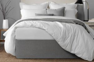 Dislike the Look of Metal Bed Frames, Box Springs, and Bedskirts? Two Solutions.